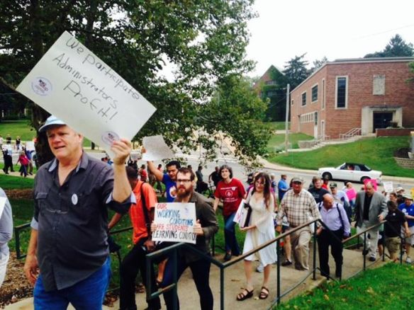 Image of faculty members marching and carrying signs in support of WMU-AAUP bargaining team (2014).