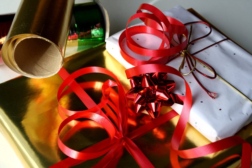 image of holiday gift and wrapping materials