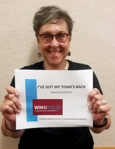 photo of Carol Weideman holding WMU-AAUP solidarity sign