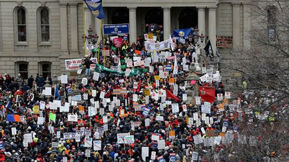 Photo of protestors outside the Michigan state capitol building